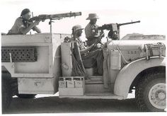 "Long Range Desert Group 1942 - Imagine you are a young man, full of testosterone, and some joker comes up to you and says, ""We will pay you to drive around in the desert in a chopped Chevy truck with a bunch of your friends, and shoot fascists with a Lewis gun. Oh, you also get to wear a pith helmet."" How could you resist?"