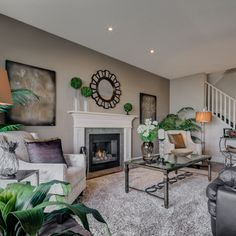 This Madison E is our new show home in Forest Ridge and the design is an amazing double-attached garage home plan. Decor, Home, Show Home, Furniture, Color Schemes, Great Rooms, Furniture Placement, Room, Fireplace