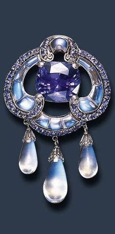 rare moonstone & sapphire brooch, by louis comfort tiffany of tiffany & co.