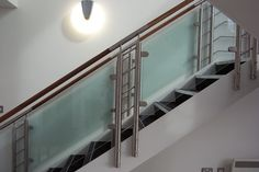 Glass staircase balustrade design with timber handrails, glass infills and bespoke stainless steel fabricated posts. Timber Handrail, Stairs Balusters, Stair Railing, Balustrade Design, Glass Balustrade, Stainless Steel Staircase, Staircase Landing, Material For Sale, Glass Stairs