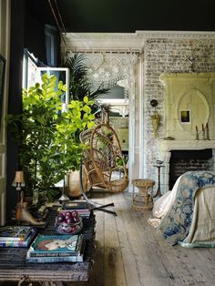 Boho vintage interior loving room exposed brick swinging wicker rattan chair.