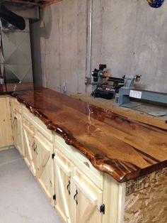 Bathroom vanity pine slab counter top with honey minwax for Log cabin kitchen countertops