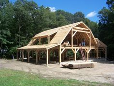 Cordwood frame with gambrel roof - like the structure design of this, smaller for a cabin maybe?