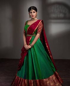 In a green & maroon color half saree and elbow length sleeve blouse design Lehenga Saree Design, Half Saree Lehenga, Lehnga Dress, Saree Look, Lehenga Designs, Bridal Lehenga, Saree Wedding, Anarkali, Party Wear Indian Dresses