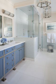 Blue and White Modern Master Bathroom with Glass Tile