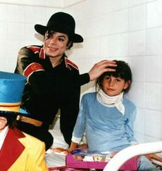 Visiting hospitals and orphanages while on tour. Michael not only gave over USD 300M to charity, he also gave his time and heart. How many stars can you think of who did/do the same thing ? not many, huh?  anyone can give money, but It's giving your time what counts more. That's a true Humanitarian.   I Love Michael Jackson for the man he was beyond his talent.<3