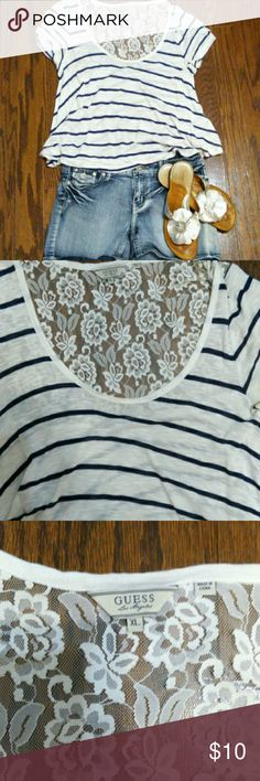 Guess Lace  top Blue and white stripe lace top, loose fitting, sheer material, great over a cami with shorts.  Perfect for summer.  Wore once. Perfect condition.  It's an extra large but can fit medium to large so I'm going to note medium Guess Tops