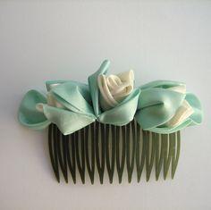 Ivory Bridal Fascinator: Kanzashi Rosebuds. $35.00, via Etsy.