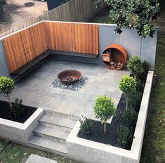 Backyard patio fire pit ideas, wood storage and bench with nice siding