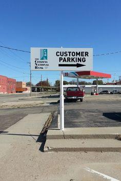 Refurbished pole sign for a bank parking lot