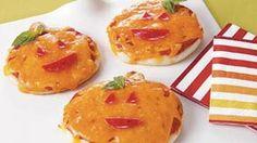 how cute! Pumpkin Pizzas
