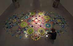 Dutch artist Suzan Drummen's large-scale floor installations are mesmerizing. The complex circular patterns composed of crystals, chromed metal, precious stones,