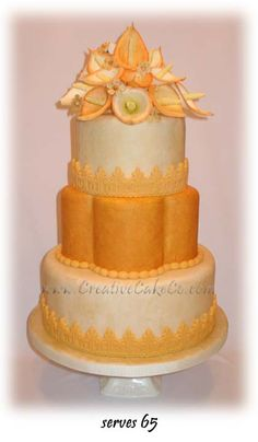 3 tier round and petal shaped wedding cake with orange and ivory calla lilies by Creative Cake Co.