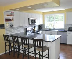 Contemporary Kitchen With White Subway Tile, Deep Anthracite Solid Surface  Countertop, Corian, Built