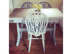 """Vintage rustic farmhouse style solid oak table and 3 chairs (I do have another if needed but it dos not completely match these)  Please ask for picture   Chalk painted French grey   45"""" long  28"""" wide 29"""" high  Leaf = 12"""" with both out 24"""" extra length"""