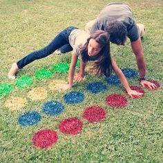 Outdoor games can be temporary like these painted spots for Twister or you can add more permanent options such as a giant chess or checkers board made out of pavers!