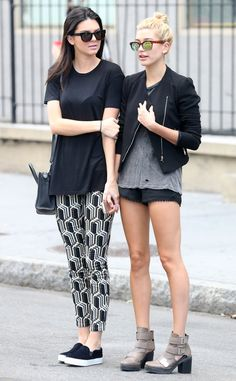 Gal Pals from Kendall Jenner's Street Style With Hailey Baldwin, the 19-year-old model hails a cab in NYC wear an oversized black T-shirt and eye-catching printed leggings.