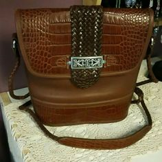 """Brighton leather cross body handbag Very good pre owned condition. Authentic Brighton leather cross body. Measures approx. 9"""" x 9"""". Silver hardware. Inside zippered pocket. Outside back pocket. Minimal wear. Strap drop is approx. 20"""". Front flaps over with magnetic snap closure. Bucket style bottom. Brighton Bags Crossbody Bags"""