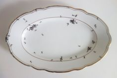 German artist Evelyn Bracklow's hand-painted porcelain dinnerware, (platter shown here) looks like it's absolutely crawling with little black ants. available through her Etsy site, Laphile. via Design Faves