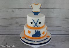 Hockey themed baby shower cake