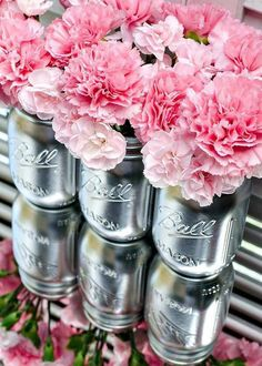 Centerpiece idea using silver mason jars and pink carnations.  Cute!