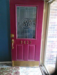 "A red door says ""Welcome""."