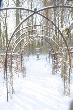 Even when there is no green, the rose arches offer structure.the eye is delighted with the urn as its' destination point. Garden of Claus Dalby. Winter Love, Winter Snow, Garden Art, Garden Design, Rose Arbor, Garden Arches, Winter Scenery, Most Beautiful Gardens, Frozen In Time
