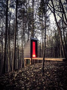 This long drop composting toilet by Invisible Studio provides facilities for the practice's self-built woodland workshop in England
