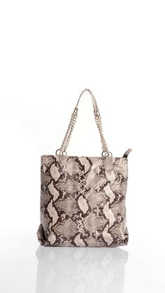 Snake print shopping bag, silver steel chain handles, inner pocket with zip closure, inner telephone pocket, top zip closure, 36 x 38 cm