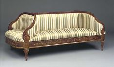 AN ITALIAN MAHOGANY AND MARQUETRY DOUBLE SIDED SOFA SECOND HALF 19TH CENTURY Decorated throughout with scrolling foliage, the panelled frieze rails with rosettes and palmettes, on cabriole legs.