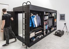 This space-efficient box creates a separate sleeping area and compact storage solutions for studio apartments.