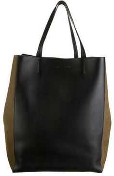Céline Phantom Cabas Tote w/ Tags, Black and moss green Céline Phantom Cabas leather and suede tote with interior zip pockets and leather tie at top. Dust bag included. Shop Céline designer bags online at The RealReal.