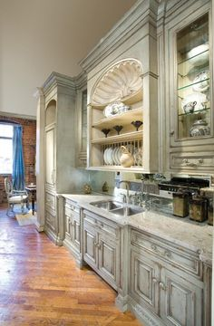 Love the cabinets, open shelves, shell detail above the sink...makes the look.