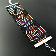 Best Bracelet Perles 2017/ 2018 : Hypnotizing bead loomed black and colorful bracelet by CatsWire