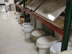 Toilets and sinks for sale.
