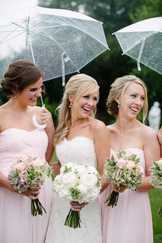 These girls aren't melting in the rain! Nothing but smiles for this bridal party // Photo by Tracie Ancelet #bridesmaids #weddingrain #castletonfarms #bridesmaidsdresses
