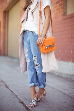Delightfully ripped boyfriend jeans and proenza schouler bag