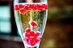 Frozen pomegranite seeds to keep champagne cool