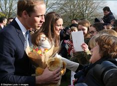 The Duke and Duchess receive well-wishes, congratulations, cards, teddy bears and flowers from the crowds outside the Child Bereavement center