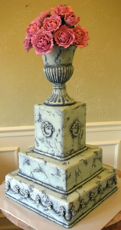 My Stone Urn & Peonies cake by With Love & Confection was featured in Cake Central Magazine June 2010.  The cake is covered in fondant to look like a weathered concrete garden ornament. The urn is made of gingerbread and covered in fondant. The peonies are handmade in gumpaste.