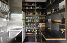Sydney architect Anthony Gill - flat in Harry Seidler Bldg open shelves