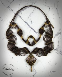 Necklace, handmade macrame, ethnic-inspired. Perfect for casual wear or to wear your most sophisticated looks.  Made with waxed polyester yarn, thread C-Lon, matubo rockery, miyuki rockery and gold aged piece.  Closure running knot. (Choose your closure: button, snap hook, running knot, ball, etc.)  Any piece can be customized or adapted to your preferences. If you have something in mind that you can not find anywhere, consult me, maybe we can materialize.  Ethnic Collection.