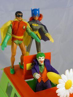 Batgirl and Robin sneak up behind the Joker in his Joker Mobile!