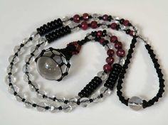 Himalayan Crystal ball gemstone necklace - faceted red Ruby and Crystal beads - smooth black Onyx - black macrame - Timeless Jewelry