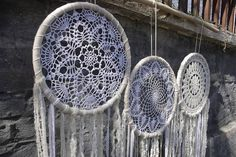 This large multiple dreamcatcher wall hanging is love from the first sight. Its intricate pattern of the crochet doily, carefully chosen lace, ribbons and yarn of different texture, shades of ivory and cream at the bottom will make you fall in love with it. These breathtakingly