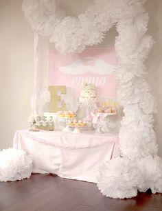 Reveal: Little Angel First Birthday Party Angel-Themed First Birthday for a Miracle Baby - we love the fluffy tissue pom garland!Angel-Themed First Birthday for a Miracle Baby - we love the fluffy tissue pom garland! Birthday Party Table Decorations, Birthday Party Desserts, Birthday Party Tables, Baby Birthday, First Birthday Parties, First Birthdays, Birthday Garland, Birthday Angel, Birthday Ideas