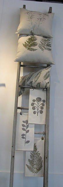 Handmade Tea Towels & pillows made of organic cotton & hemp displayed on vintage ladder