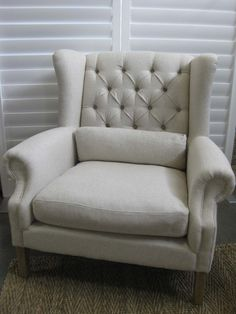 Elegant and sophisticated, the Ralph Chair is a timeless classic, suited to a French inspired or a  Hampton's decor. Fully upholstered in ecru linen with rolled arms, buttoned detail and stud trim try. Interiorsonline.com.au $1349