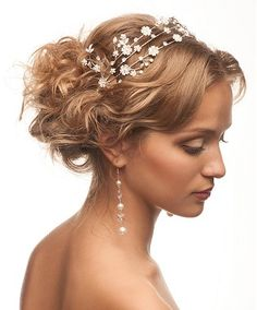 A medium blonde straight coloured bridal wedding tiara Womens hairstyle by Wedding Collections