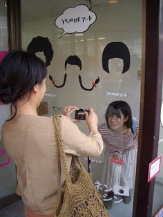 Fun idea for a party: draw different hairstyles on a window so that your guests can take funny pictures.